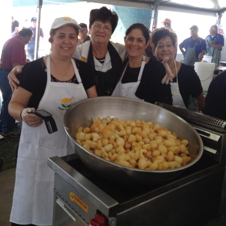 Some of the ladies making honeypuffs at the Paniyiri